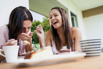 Teenage girls laughing at lunch